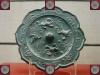 tang_dynasty_bronze_mirror_with_relief_decoration